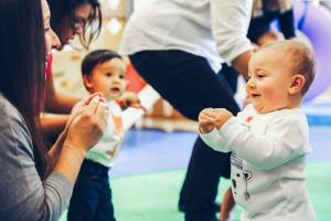 Encourage physical development in infants/toddlers